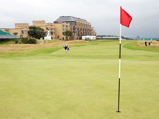 Hole 17, St. Andrews Old Course: known as The Road Hole, it is the toughest hole of the course. Proving to be a more formidable opponent than Rory McIlroy is the plethora of wayward golf balls hitting the roof of The Old Course Hotel Golf Resort and Spa - hence the rubber roof solution! Image by Alessandro Colle (via Shutterstock).