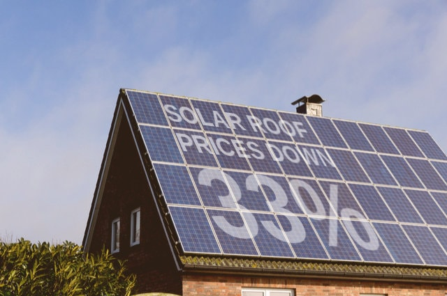Solar Roof price cut image by OFC Pictures (via Shutterstock)
